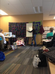 Leah demonstrating a pattern before we dig in on the sewing machines