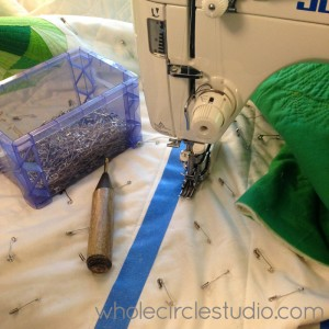 straight line quilting  :  always feel productive taking out safety pins!
