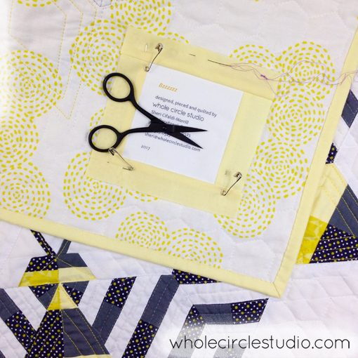Day 22: 365 Days of Handwork Challenge— The glamorous work of attaching necessary quilt labels before quilts ship out! Whole Circle Studio — 365 Days of Handwork Challenge