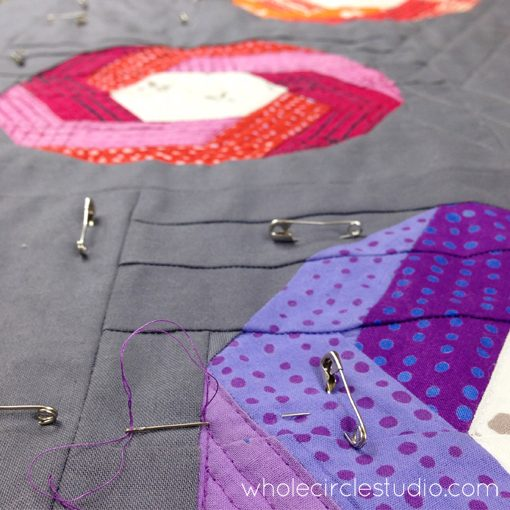 Day 23: 365 Days of Handwork Challenge— burying threads with my cheater needles as I quilt my Shutter Snap quilt made with Chroma by Alison Glass. Whole Circle Studio — 365 Days of Handwork Challenge