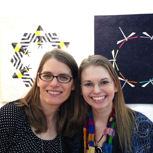 Sheri Cifaldi-Morrill and Leah Day in Whole Circle Studio's booth: Fall Quilt Market 2016