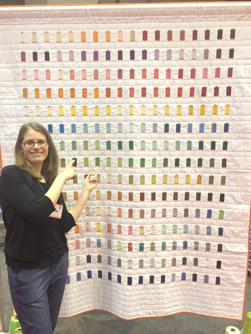 Sheri Cifaldi-Morrill | Whole Circle Studio with her quilt, 270 Colors, designed and made to celebrate the 10th anniversary of Aurifil USA.