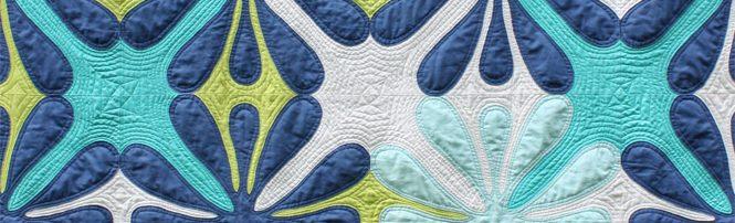 Big Island Blossoms by Sheri Cifaldi-Morrill | Whole Circle Studio. A modern, Hawaiian-inspired quilt.