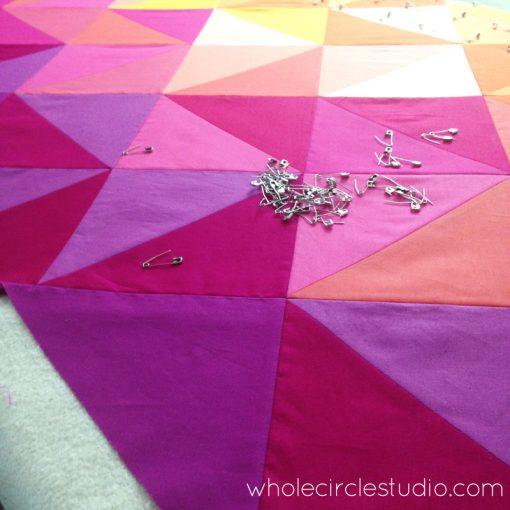 Basting Sun Salutation quilt. Quilt pattern by www.wholecirclestudio.com