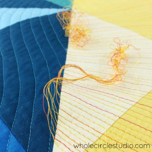 Burying sun ray threads in Sun Salutation quilt. Quilt pattern by www.wholecirclestudio.com