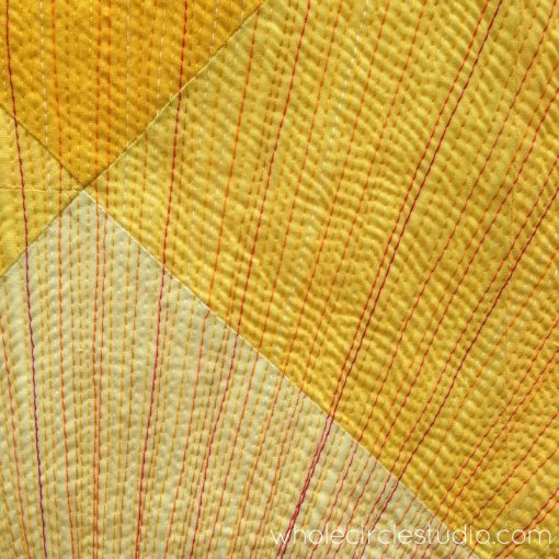 Detail of quilting sun rays in Sun Salutation quilt. Quilt pattern by www.wholecirclestudio.com