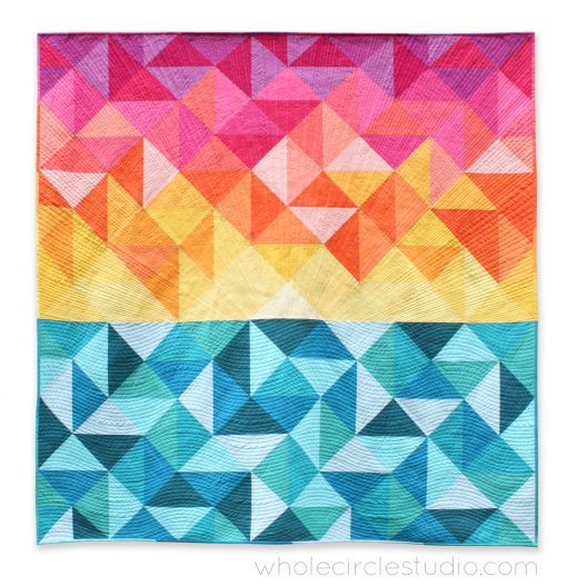 Sun Salutations, a modern spin on the traditional half square triangle quilt block. A beautiful gradient of solid fabrics lend itself to this Hawaiian-inspired sunrise quilt design. Pattern by Whole Circle Studio.