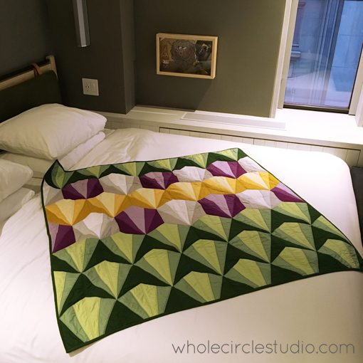 Day 260: / I spent Christmas Night sewing on a label to this Deco Daybreak Quilt (pattern available at http://shop.wholecirclestudio.com). Forgot to take a photo that night, so here's a photo a few days later minutes before I gifted it! Whole Circle Studio — 365 Days of Handwork Challenges