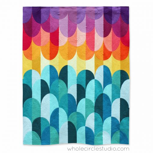 Kona Sunset, a modern curve Drunkard's Path quilt using solid fabrics. Inspired by Hawaiian sunsets on the Big Island in Kona. Design by Sheri Cifaldi-Morrill of Whole Circle Studio.