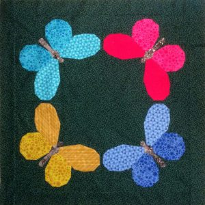 Butterfly Bunch made by Joanne Harris. A cute foundation paper pieced pattern. Makes a great gift for a baby, child or nature enthusiast! Make a wall hanging or mini quilt.