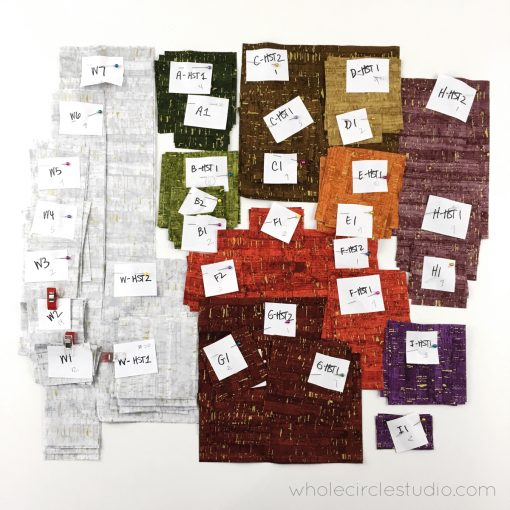 Lots of fabric strips and squares labeled. Organization makes quilting making more pleasant and you'll make less mistakes!