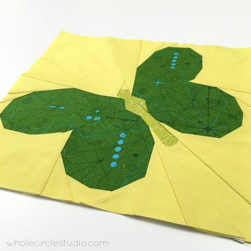 An assembled Butterfly Bunch quilt block. A foundation paper piecing pattern by wholecirclestudio.com