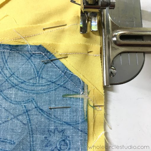 "Sewing quilt blocks together using my seam gauge set to a 1/4"". This moveable seam gauge makes for the perfect seam allowance!"