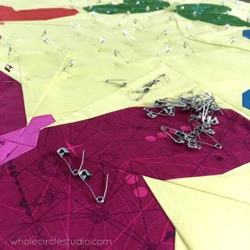 Preparing my Butterfly Bunch mini quilt for quilting. Be sure to check out my blog for tips and tricks for pin basting your quilt sandwich.