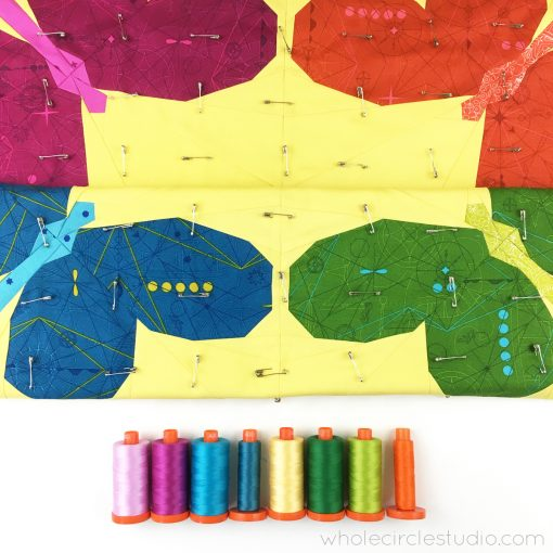 Want to hide imperfections in your quilting? Matching your thread to the area you're quilting is one of my biggest quilting tips! I love using Aurifil 50 wt. cotton thread when quilting.