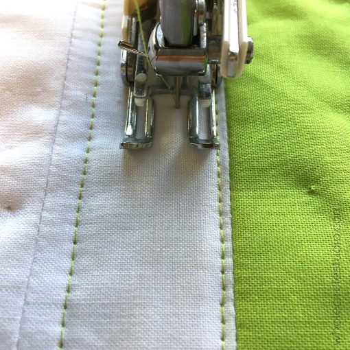 I often use the seams in my quilt top as a guide when quilting with my walking foot. I then use those quilted lines as a guide.