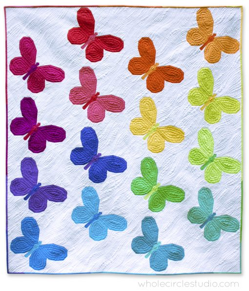 A modern, rainbow version of Butterfly Bunch quilt. Fabric: RJR Cotton Supreme Solids. Pieced and quilted with Aurifil 50 wt. cotton thread.