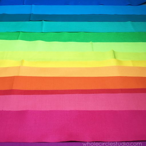 Rainbow fabric strips to be made into binding. Fabric: Cotton Supreme Solids by RJR Fabrics.