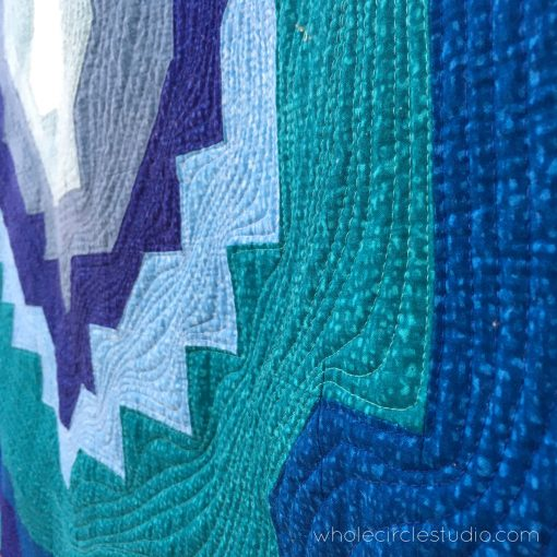 detail of Stone Slice quilt with modern, organic quilted wavy lines with my walking foot to emulate the layers of a geode. Quilted on my Juki2010 with Aurifil 50wt cotton thread. Pattern by Whole CIrcle Studio