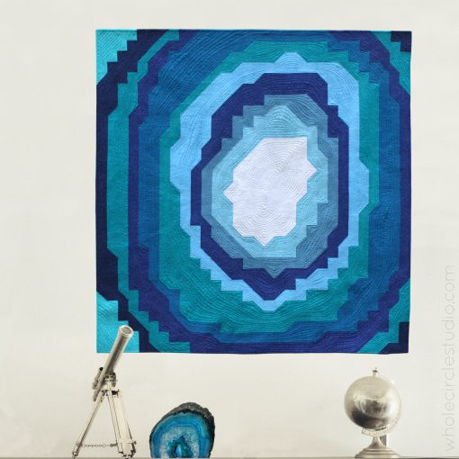 Stone Slice: a modern, easy quilt pattern inspired by geodes, rocks and crystals. This is the perfect quilt pattern to make a gift for a budding geologist or stone / crystal lover! Instructions come in 3 sizes: mini, throw and queen and is friendly for the beginner quilter. Comes together with fabric strips and half square triangles (HSTs). Pattern by Whole Circle Studio