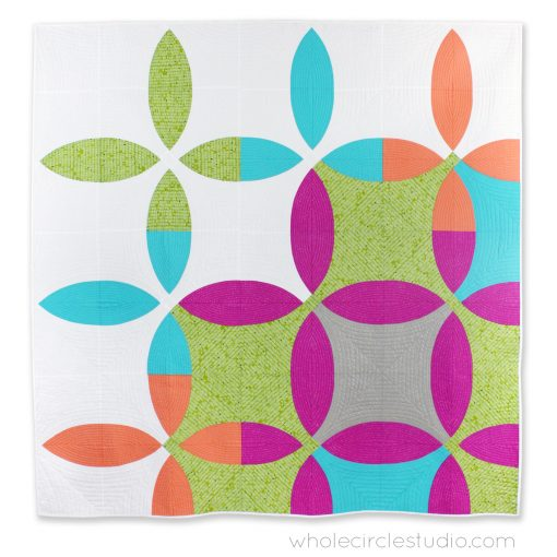 Picnic Petals quilt: a modern spin on the traditional flowering snowball quilt. This quilt features a nice gentle curve, making it easy for beginners (or those with anxiety about piecing curves) to piece! Pattern by Whole Circle Studio