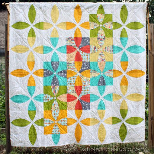 Picnic Petals is a modern quilt based on a traditional Flowering Snowball block. This tested pattern contains both detailed instructions and diagrams, making it easy to piece. Instructions are provided for three sizes: Throw, Twin and Queen. This version of the quilt was one of three winners out of 750 entries in the 2014 Modern Quilt Guild/Michael Miller Challenge