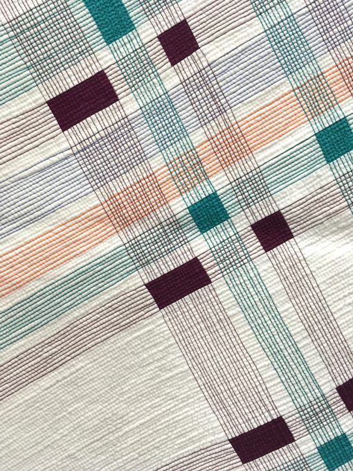 "detail of ""Pivoted Plaid"" by Cassandra I. Beaver. Modern Use of Negative Space quilt"