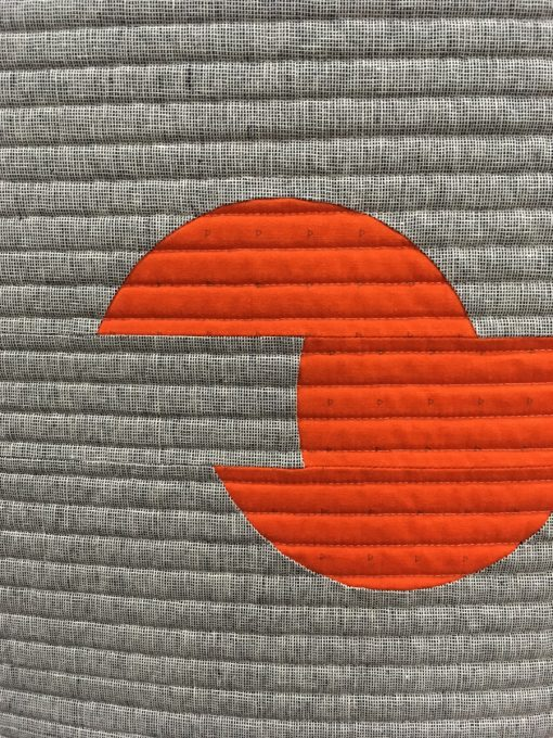 "detail of ""Sliced Circles"" by Karen H. Lee. Quilted by Christina Lane. Modern Minimalist Design quilt"