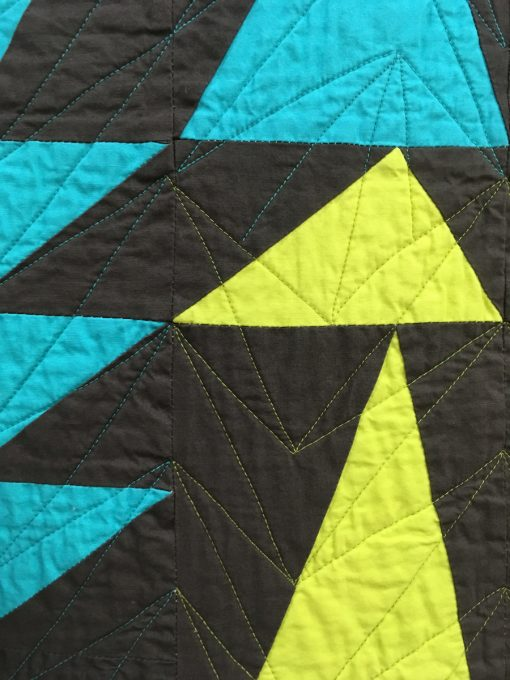 """detail of """"Rise Up"""" by Kendra Nitta. merican Patchwork & Quilting Flying Geese Challenge"""