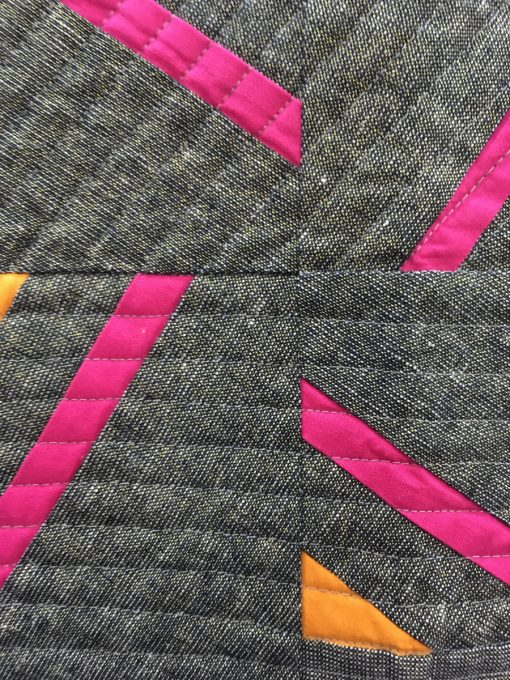 "detail of ""Neon Lights"" by Jen Sorenson. Modern Piecing Category"