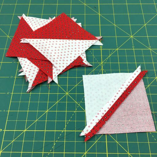Video and photo tutorial on how to make 8 half square triangles (HSTs) at once using the Magic 8 method. Step 13. Visit blog.wholecirclestudio.com for more info