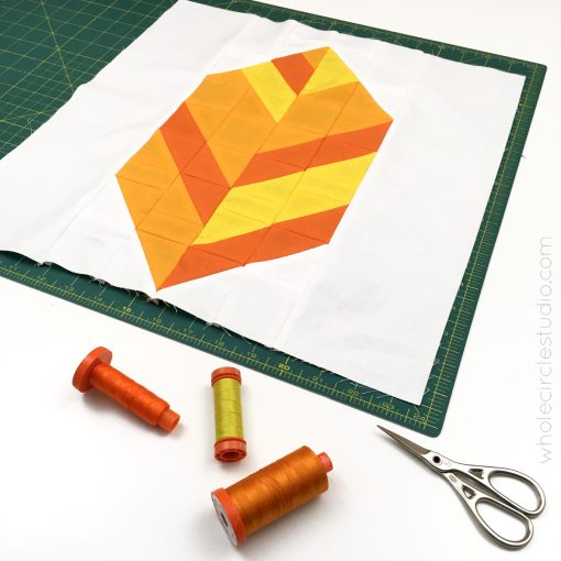 Leaf Peepers Quilt Pattern: Block 3. A modern, graphic spin on the traditional half square triangle. A great PDF pattern to use with solid fabric, prints or batiks! Pattern available at wholecirclestudio.com