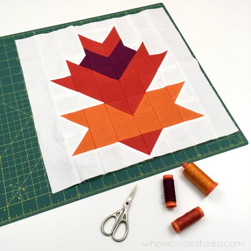 Leaf Peepers Quilt Pattern: Block 4. A modern, graphic spin on the traditional half square triangle. A great PDF pattern to use with solid fabric, prints or batiks! Pattern available at wholecirclestudio.com