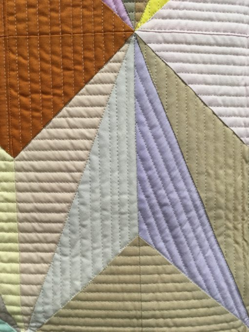 "detail of ""Aura"" by Nydia S. Kehnle. Quilted by Gina Pina. Category: Piecing Modern Quilt"