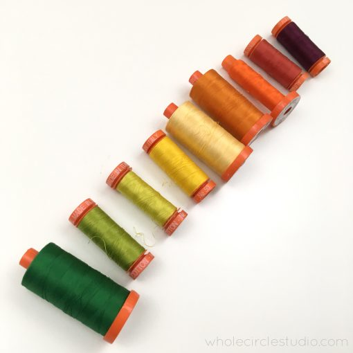 A beautiful selection of fall-inspired cotton thread by Aurifil. Curated by Sheri Cifaldi-Morrill of Whole Circle Studio for the Leaf Peepers quilt.