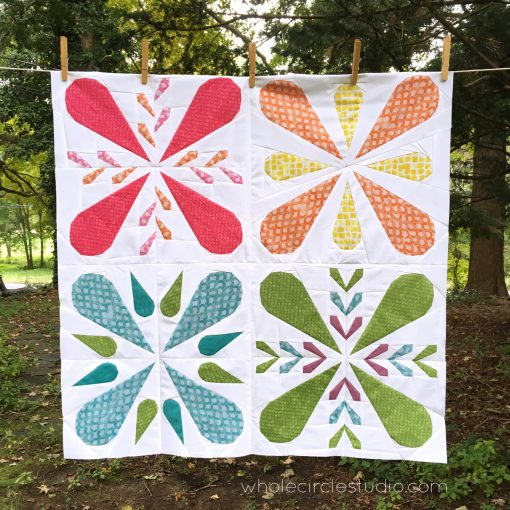 Patchwork Petals mini quilt, a foundation paper piecing pattern, ready to be quilted. Fabric: By Handd designed by Amy Friend. Patchwork Petals pattern for sale at wholecirclestudiocom