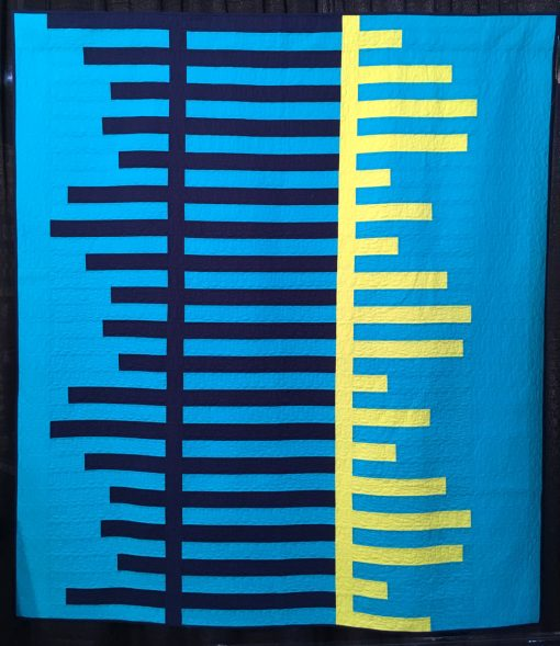 """Periodicity"" by Cheryl Brickey Statement: ""Periodicity shows the beauty and rhythm of periodic waves in this high contrast and vibrant quilt. It was quilted with horizontal rows of loops using a matching thread color for each section to give the quilt texture but not take away from the bold fabrics."" [Design Source: Periodic waves] displayed in the 2018 Modern Quilt Showcase sponsored by the Modern Quilt Guild at the International Quilt Festival in Houston"