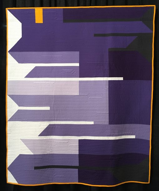 """Fringe Area"" by Heather Black. Statement: ""Fringe Area was designed for this year's Pantone Color of the Year quilt challenge. The Color of the Year for 2018 is ultra-violet, and I wanted a design that featured almost entirely shades of purple. I named the quilt Fringe Area because ultra-violet is just out of the range of visual light on the electromagnetic wave scale."" [Design Source: Pantone Color of the Year] displayed in the 2018 Modern Quilt Showcase sponsored by the Modern Quilt Guild at the International Quilt Festival in Houston"