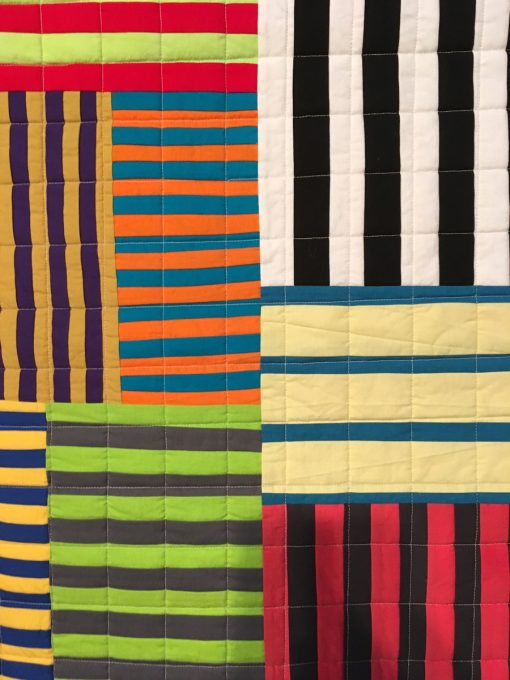 """detail of """"Striped Chaos"""" by Maria Shell displayed in the 2018 Modern Quilt Showcase sponsored by the Modern Quilt Guild at the International Quilt Festival in Houston"""