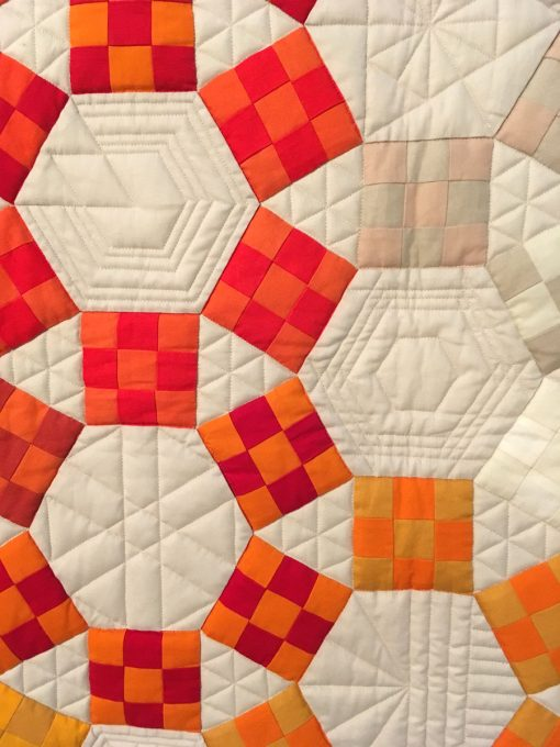 "detail of ""Unchained Melody"" by Jackie Benedetti. Quilted by Dionne Matthies-Buban. displayed in the 2018 Modern Quilt Showcase sponsored by the Modern Quilt Guild at the International Quilt Festival in Houston"