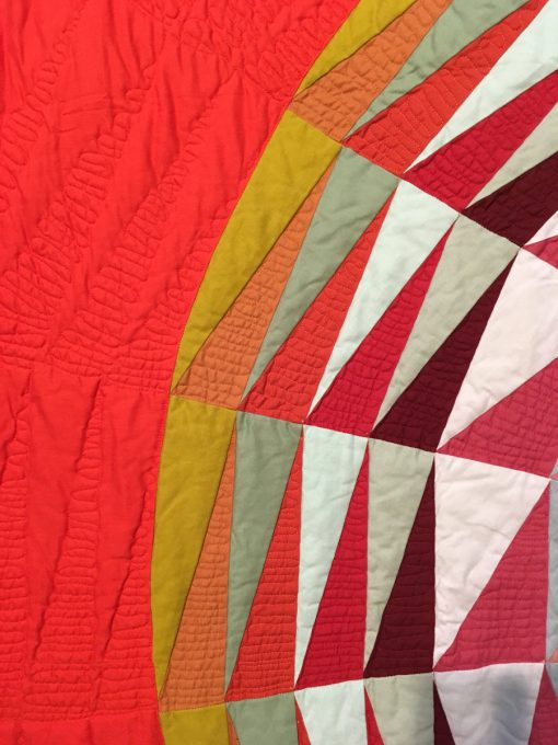 "detail of ""Radiant"" by Maritza Soto displayed in the 2018 Modern Quilt Showcase sponsored by the Modern Quilt Guild at the International Quilt Festival in Houston"