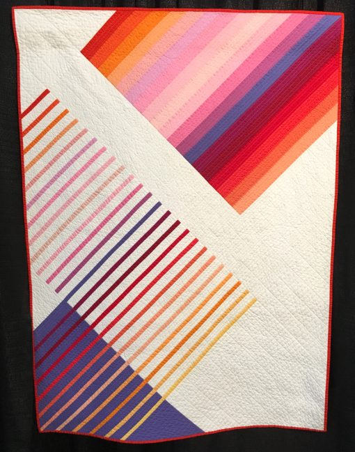 """""""Color Glide-Summer"""" by Juli Smith Statement: """"This really started as an exercise to explore how the same color array would react in different widths and with different background, but in the same quilt. I explored the world of color gradations to learn more about color values and hues. My goal was to use solids to find harmony and balance between the color and negative space. I call this color simplicity. Color Guide-Summer included 24 Kona solids against the white backdrop."""" [Design Source: Original Design] displayed in the 2018 Modern Quilt Showcase sponsored by the Modern Quilt Guild at the International Quilt Festival in Houston"""