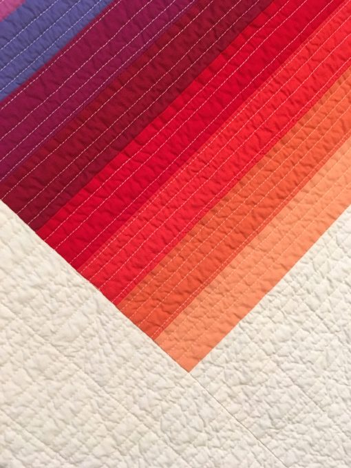 """detail of """"Color Glide-Summer"""" by Juli Smith displayed in the 2018 Modern Quilt Showcase sponsored by the Modern Quilt Guild at the International Quilt Festival in Houston"""