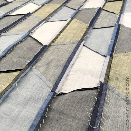 Piecing and pressing of strips: Hexie Blues quilt pattern by Whole Circle Studio