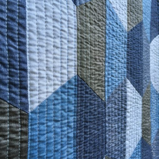 Detail of Hexie Blues quilt. Made with Art Gallery Fabrics Denim Studio (variety of colors) and pieced and quilted with Aurifil Cotton Thread. Batting: Warm and Natural by The Warm Company. Pattern by Whole Circle Studio