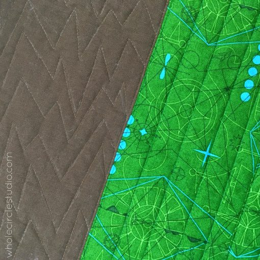 Quilting Sasquatch with a walking foot, a modern commissioned quilt, by Sheri Cifaldi-Morrill of Whole CIrcle Studio