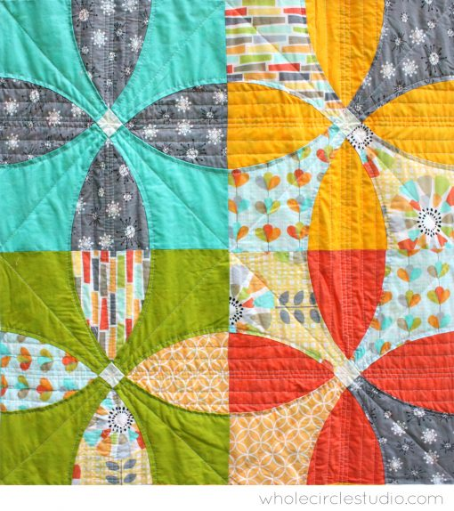 Detail of Picnic Petals is a modern quilt based on a traditional Flowering Snowball block. Pattern by Whole Circle Studio.