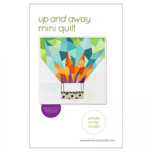 Make Up and Away mini for your next quilt swap or as a gift. This 18″ x 18″ quilt is great as a wallhanging — add a border to make an oversized pillow or make multiple blocks and construct a larger quilt! This is the perfect pattern to use up your fabric scraps! If you need additional fabric to complement your stash, charm packs and fat eighths work well with this pattern. This tested pattern contains both detailed instructions and diagrams, making it easy to piece. Pattern by Whole Circle Studio.