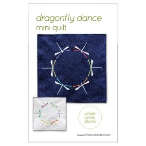 Dragonfly Dance is a graphic wallhanging / mini quilt that uses foundation paper piecing techniques. Make additional blocks to make a larger quilt (layout ideas are provided to make a lap, twin or queen quilt). This tested pattern contains both detailed instructions and diagrams, making it easy to piece. Pattern by Whole Circle Studio.