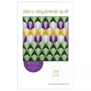 Deco Daybreak is an easy, beginner-friendly foundation paper piecing pattern. The design incorporates the repeat of a foundation paper-pieced block. Use my color selections as inspiration or customize the pattern using the supplied coloring sheet. Instructions are provided for four sizes: Throw, Twin and Queen. Pattern by Whole Circle Studio.